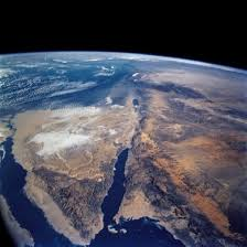 """The Dead Sea from Earths Orbit. 25 miles east of Jerusalem; 53 miles long, 10 miles wide, and 13,000 feet deep at its greatest depth. Being 1310 feet below sea level, it's surrounded by hills and mountains, which make it an immense hole in the ground.   The Jordan River pours 7 million tons of water into the Dead Sea every DAY, 24 hours a day. There is NO ESCAPE of that water except through evaporation and the MINERALS contained in the water are ALL left behind IN the Dead Sea.  """"This will be a PERPETUAL source of wealth for the NATION that CONTROLS the DEAD SEA."""""""
