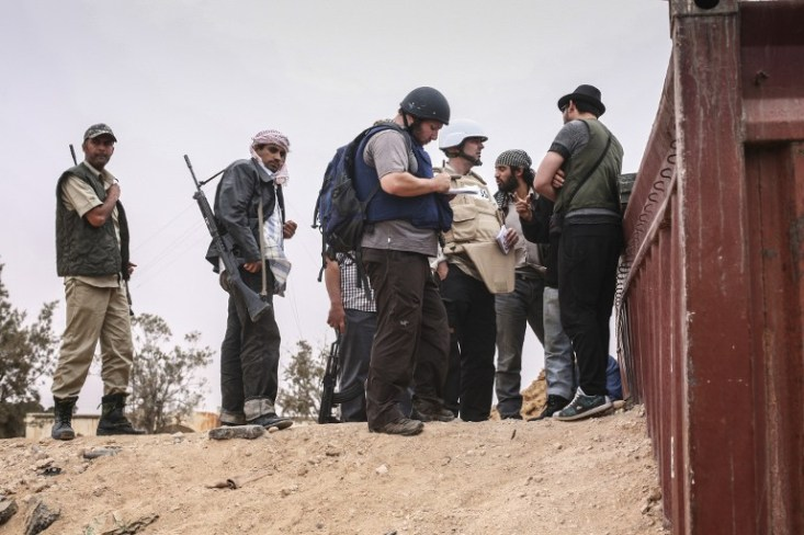 June 02, 2011 American journalist (and suspected Mossad Operative) Steven Sotloff (center with dark helmet) talking to Libyan rebels on Al Dafniya front line, 25 km west of Misrata.